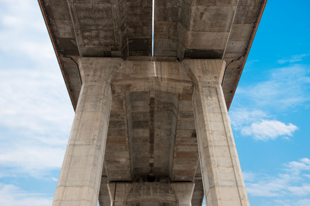 Under bridge expressway with blue sky and white cloud photo