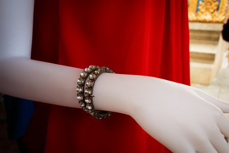 falsity: Fake bracelet diamond for accessory on mannequin in clothes shop