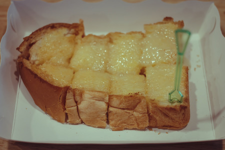 sweetened: Toast with butter and sweetened milk
