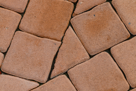 red brick wall: Pattern of brick block on walkway,The triangle block is difference.