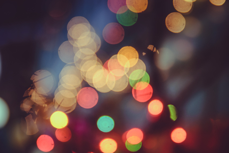 lighting background: Bokeh abstract rainbow spot colorful background from decorative lighting on the tree