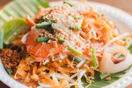 The traditional Thai food Pad Thai Noodles with shrimp and vegetables on foam dish
