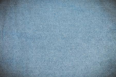742b4de4f Textura de mezclilla jean azul sobre fondo