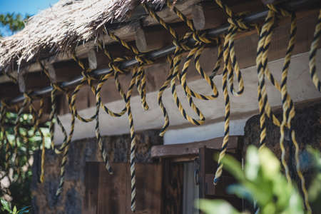 The scenery of the rope tied on the roof inside Seongeup Folk Village in Jeju Island, South Korea.