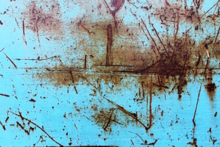 scratched the surface of a rusty blue background photo