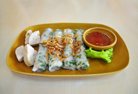 cuon: Banh Cuon, Steamed Fresh Rice Flour Rolls with shallots and ground pork Stock Photo