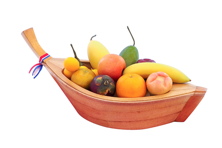 Artificial fruit in a small boat fabricated in thailand