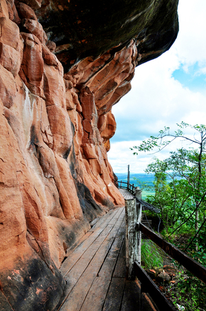 The wooden corridor loop around the sandstone mountain, Phu thok temple district Bueng Kan, Thailand