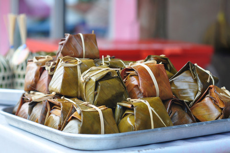 Khao tom mat or Banh Chung. A traditional vietnam dessert prepared from sticky rice, pig, and mung bean. Commonly eaten in the new year holidays.