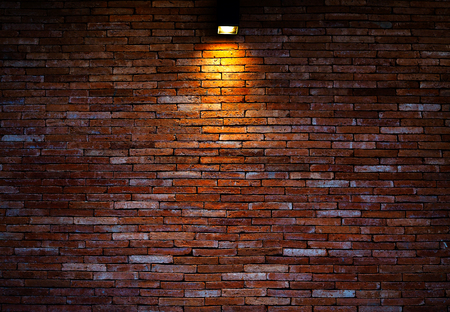 Brick wall background. The lamp shines to the wall.