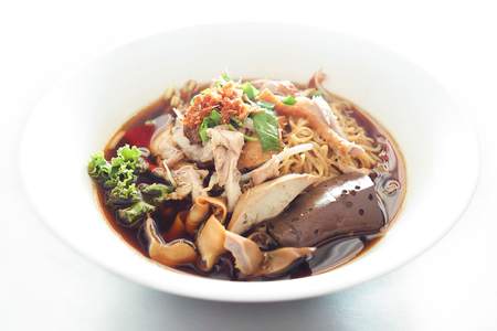 Noodle soup stewed duck put the blood and animal offal. Thailand food Chinese style.