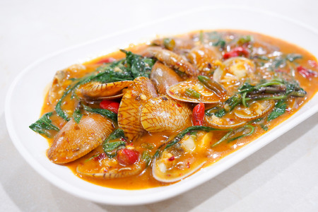 Stir fried clams with roasted chili paste, Thailand food.
