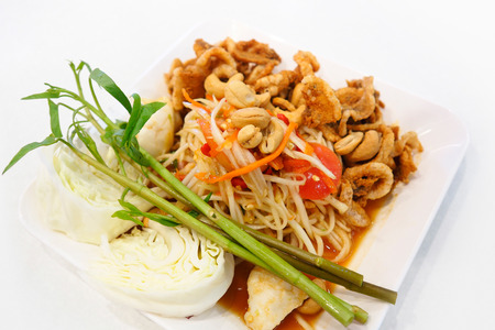 Papaya salad (somtum) with salted eggs and fried pork rind