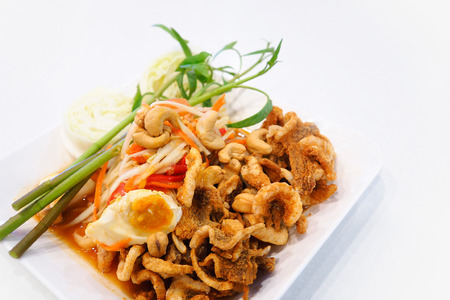 Papaya salad (somtum) with salted eggs and fried pork rind.