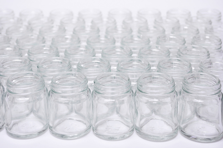 Short glass bottle no cap many glasses row, on white background. Banque d'images