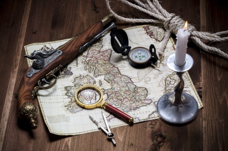 deification: old map with the deification on a wooden table