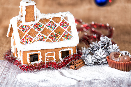 cone cake cone: traditional gingerbread house on a background of Christmas decorations