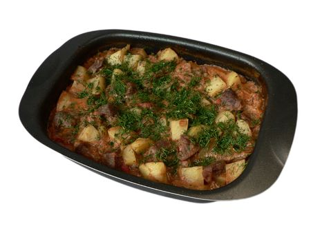delicious goulash in dish, cooked from beef, potatoes, tomatoes, parsley