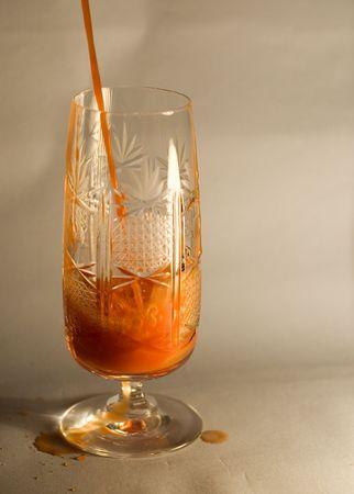 wineglass with liquid tomato juice