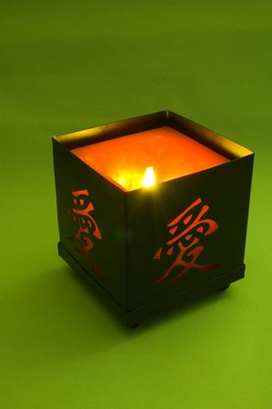 candle with hieroglyph on green Stock Photo