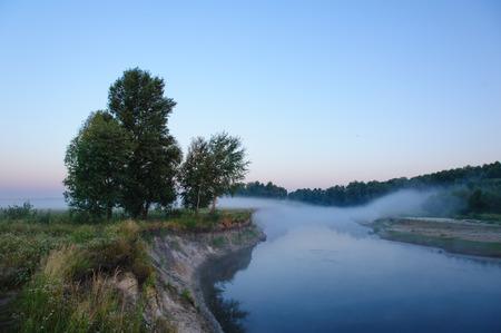 non urban: Morning fog looks like a bridge over the river