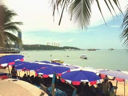 pattaya: Umbrellas beach in Pattaya bay Thailand. Stock Photo