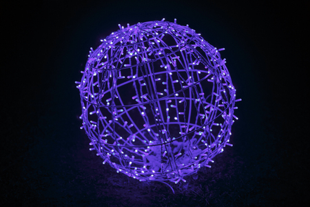 Glowing blue garland in the shape of a ball. Christmas night blue light for holiday. Electric garland, garland, electrical, shine light glow world society color shine glow radiate beam