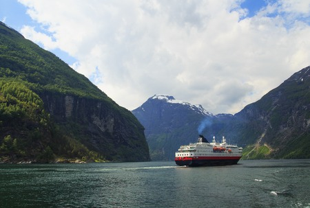 Landscape with Geiranger fjord with cruise ship, mountains. Beautiful Nature Norway.