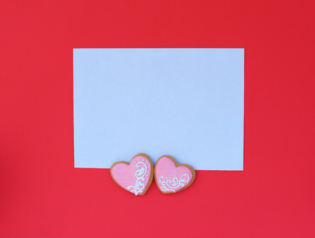 Composition modern gifts on a white envelope with a pink hearts on red background.. Valentine's Day. Christmas, Woman's day, Mother's day background. Flat lay. Wedding Invitation