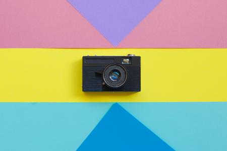 Fashion Film Camera. Hot Summer Vibes. Pop Art. camera. Hipster Trendy Accessories. Sunny summer Still life. Bright Sweet fashion Style. Surreal, Minimal Fun.Vanilla Pastel Color