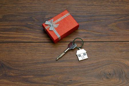 Buying an apartment. mortgage, housing as a gift, housing for a young family. Key, gift box Stock Photo