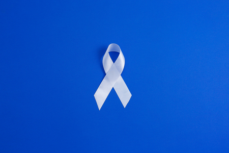 White color ribbon for raising awareness on Lung cancer and Multiple Sclerosis and international day of non-violence against women. Medicine concept. concept of violence