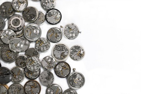Details of clocks and mechanisms for repair, restoration and maintenance on a white background. Pocket watches details. 免版税图像