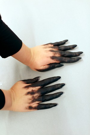 Halloween vampire. Hands with scary manicure. halloween nail. Black polish