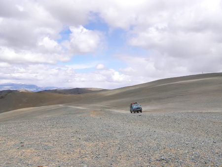 Foreign tourists in cars traveling on the roads of Mongolia