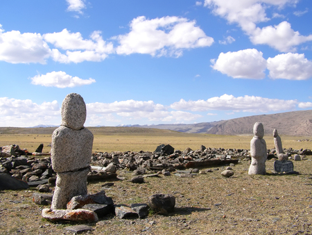 Ancient gravestones in the steppes of the Mongolia. Mongolian Cemetery.