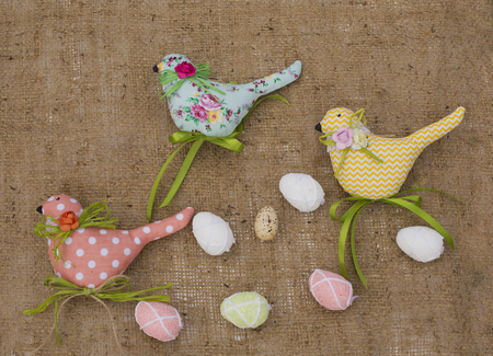 Textile spring birds and eggs. Decorative toys of handwork. Easter decorations. easter concept Banco de Imagens