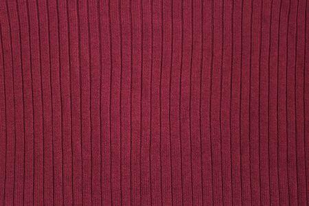 Texture of dark burgundy knitwear, Dark red knitted background