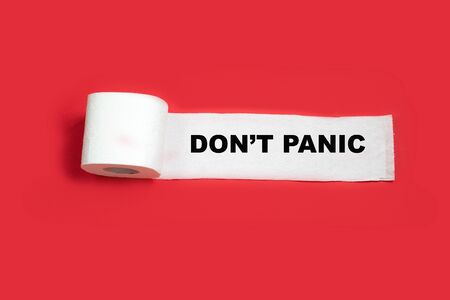 Do not panic. Roll of toilet paper on a red background. Concept of coronavirus. Preparation for quarantine and economic crisis due to coronavirus