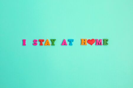 I Stay at Home phrase on blue background. Stay safe, stay inside home. Save planet from corona virus.