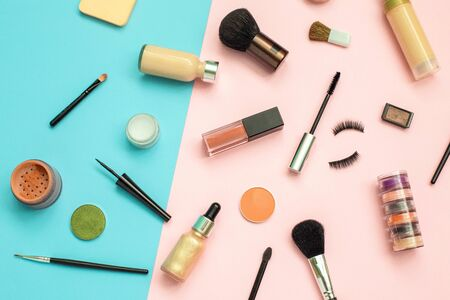 Set of decorative cosmetics on color background. Makeup cosmetics tools background and beauty cosmetics