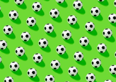 Pattern. Soccer ball on green backgraund. place for text. Game, match hobby