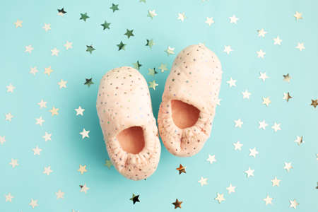 Pair of cute pink foot slippers with glitter stars