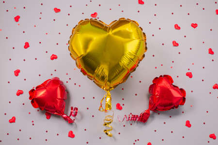 Air Balloons of heart shaped foil on festive background. Stock fotó