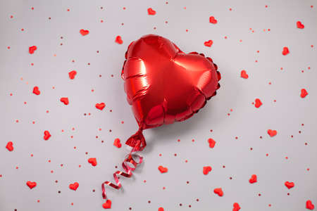 Red Air Balloon of heart shaped foil on festive background.