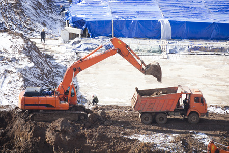 suffusion: Excavator and truck. Used soil excavation bucket Stock Photo