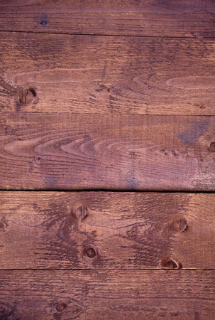 planking: wooden red planking background. Rough rustic texture