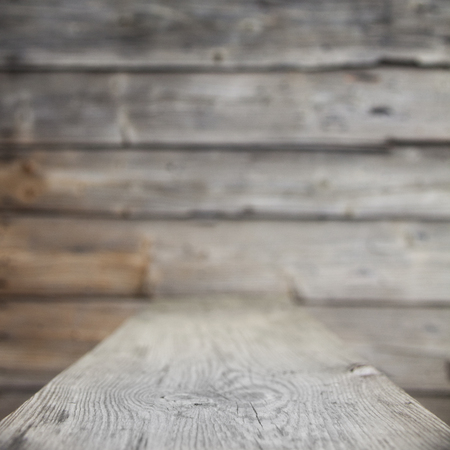 foreground: Blurred wooden background. Thin strip of focus in the foreground