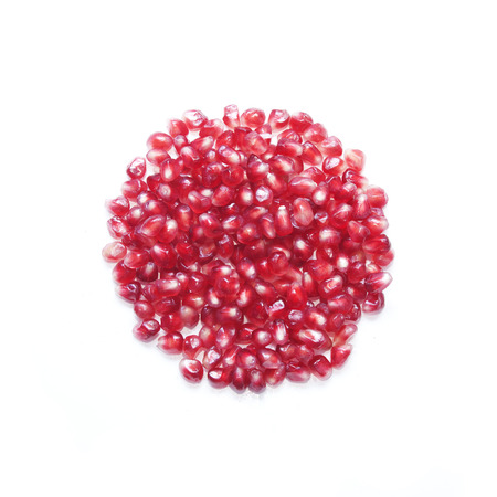 pomegranate seeds in shape of round on white background