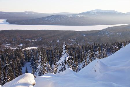 swept: View of the lake from mountain range Zyuratkul, winter landscape. Stock Photo